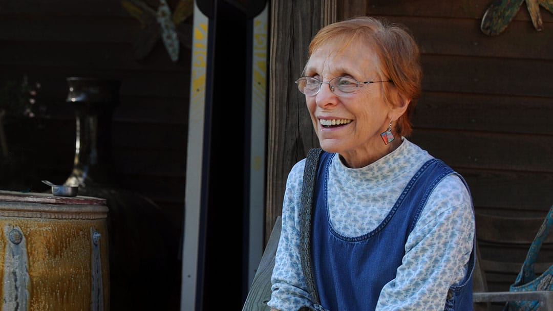 Dr. Lucy Daniels outside of a cabin